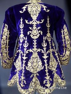 ca 1850-1890 Ottoman Empire ceremonial jacket in purple silk velvet with appliques  of silver and gold cord and gold embroidery. Lined in sky blue checkered wool challis. Really quite beautiful!