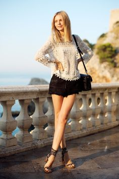 Jessica Stein of Tuula Vintage wears a DOLCE VITA top, ELLERY shorts, ISABEL MARANT sandals, and PROENZA SCHOULER bag. (September 10, 2013)