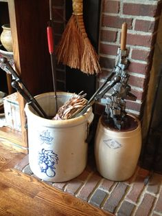 Antique Western crock and Diamond Brand butter churn with vintage cookie cutters on handle.