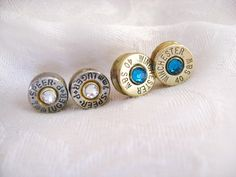 Ammo Bullet Earrings - Bullet Casing with Swarovski Crystals - 9mm, 45 caliber, 40 caliber, 30-06, 38, or any other caliber. $15.00, via Etsy.