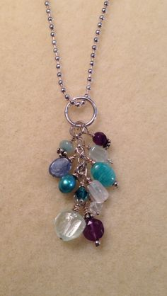 Sterling silver necklace with mixed stones $40 Aquamarine, Amethysts, Kyanite, Chalcedony, freshwater pearls, Amazonite, and Swarovski Crystals.
