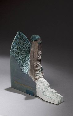 Guy Laramée turns old books into oceans, valleys, and sprawling mountain ranges.