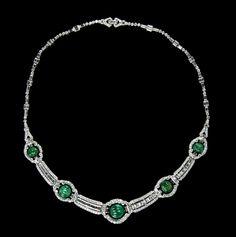 An Important Art Deco Platinum, Emerald, Diamond and En