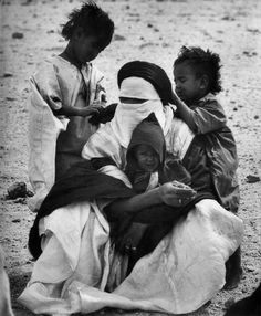 George Rodger  ALGERIA. Sahara desert. A tuareg and his children in south of Tamanrasset. 1957.