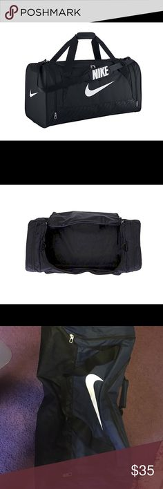 Brand new Nike duffle bag Never used!! Navy blue and black Nike bag. Too big for what I needed. Perfect condition, great for traveling. Can fit a lot! Two side pockets good for shoes Nike Bags Travel Bags