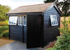 copper roof instead of cedar and shou sugi ban Japanese burnt wood black siding.