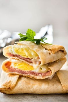 """If you are a lover of great Mexican food like I am, you have undoubtedly tried a variation of the """"ham, egg and cheese"""" breakfast quesadilla. #cheesecake #cheese #cheeselover #breakfast #breakfastideas #breakfasttime☕️ #quesadillas #quesadillas🧀 Breakfast Quesadilla, Quesadilla Recipes, Fresh Ham, Whole Wheat Tortillas, Meal Prep Containers, Ham And Cheese, Quesadillas, Breakfast Time, Cooking Time"""
