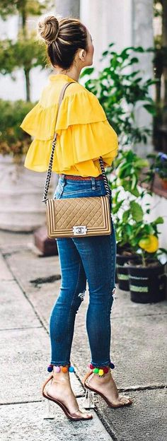 Yellow ruffled top, skinny jeans + pompom heels