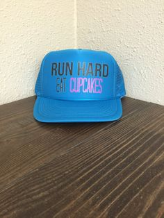 Run Hard Eat Cupcakes Hat Women's Ttrucker Ha by sunsetsigndesigns