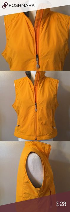 "LL Bean Vest Cheerful, like new vest from LL Bean. Cozy on the inside & water repellent on the outside! Bust measures 21"" and it's 21"" long. Size Petite medium. L.L. Bean Jackets & Coats Vests"
