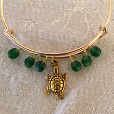 Tortoise Charm And Green Crystal Adjustable Wire Bangle Bracelet by cbfcreationsHB on Etsy