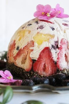 fruit + coconut ice cream cake with brownie crust #vegan #raw  Except I would make a different crust since I don't eat chocolate.  :)