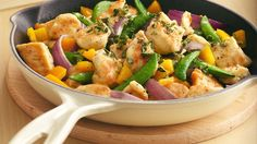 An inviting combination of chicken, vegetables, fresh herbs, and garlic--you'll be making this one again soon.