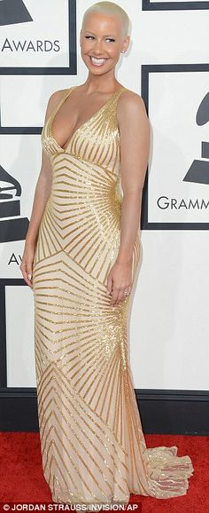 Shining example: Amber Rose sported a dramatic pale gold gown