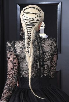 Incredible: Lady Gaga, who was born Stefani Joanne Angelina Germanotta, styled her platinum blonde tresses in an intricate and edgy braid, featuring a black string laced through her locks like a shoe lace