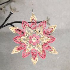 A personal favourite from my Etsy shop https://www.etsy.com/uk/listing/557188543/pink-and-white-paper-quilling-snowflake