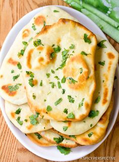 Easy Naan Recipe - Fluffy, crusty, irresistible Indian Naan Bread made in the oven. This naan bread recipe is so simple, it's perfect for new bread bakers.