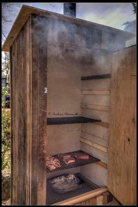 A few pictures of the smokehouse that we built. We had to take down a 100 year old smokehouse, and decided to build a smaller one from the old wood. Backyard Bbq Pit, Backyard Smokers, Backyard Seating, Smoke House Plans, Smoke House Diy, Diy Smoker, Homemade Smoker, Barbecue, Bbq Shed