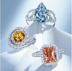 Three coloured diamond examples - blue diamond ring is Volute ring