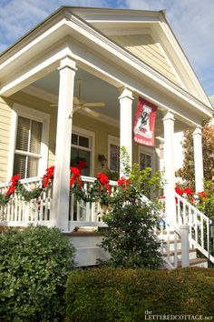 I like this porch -- railings, posts and hand rails on steps. Bet it looks good in any season. From:| The Lettered Cottage
