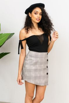#BOSSIN all day long, looking fresh and fabulous in our Black Mini skirt. Stretchy material was chosen to ensure 100% comfort and a fitted style. Hustle all day and Evolve into a badass at night!    Model wears size small  Product Description:  Back zip Faux button down Asymmetric Stretch plaid print fabric Cotton Blend Boss Babe, Stretchy Material, Hustle, Badass, Printing On Fabric, Mini Skirts, Product Description, Plaid, Fresh