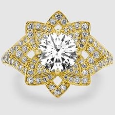 This intricate halo diamond ring reminds me of a snowflake.