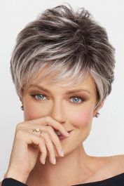 This texture filled style gives you a truly trendy look that combines classic and casual. The short style features lightly feathered bangs and light layering throughout the wig with short strands that taper down to the nape of the neck. The temple to temple lace front wig cap allows you to wear this style pushed back away from the face or tucked behind the ears thanks to the nearly invisible hair line that it creates. A monofilament top creates the illusion of real hair growth directly from…