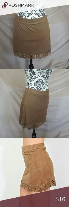 """Faux Suede Laser Cut Mini Skirt Brand new with tags! Brown faux suede mini skirt. The bottom has laser cut flowers trim. Elastic waistband and very stretchy fabric. It is super soft and comfy. Price firm unless bundled!  Measurements (laying flat, unstretched) Waist-15.5"""" Hips-17"""" Length-16"""" Jesse & J Skirts Mini"""