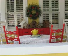 Red dining on the porch