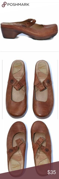 Dansko Solitaire EU 42 Mary Jane Open Back Clogs Dansko Solitaire EU 42 Mary Jane Open Back Tan Brown Leather Clogs  GUC- has minor scratches on the leather- see photos  Note to Buyers: **Colors may vary slightly from photos of item, due to lighting, camera, editing, screens, etc.**  If you have any questions, please don't hesitate to send me a message. Please feel free to check out the other items listed in my store. Dansko Shoes Mules & Clogs