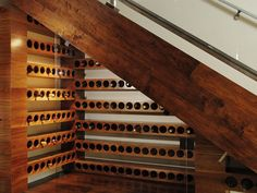 Under stair wine racks // not wine... But something else maybe.