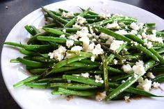 Green Beans with feta and balsamic vinegar.  2 simple additions that yield huge, rich flavor.