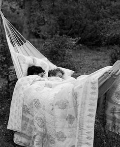 sleeping together in a hammock at night in the backyard