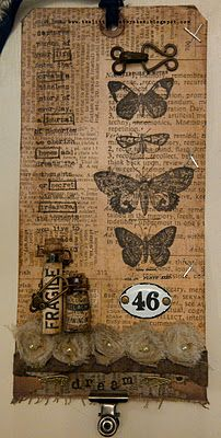 Tim Holtz papillon set, the new Tim Holtz tissue paper(thanks u know who!), trimmings, idea-ology