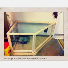 Odd enclosure but good for keeping cats from sneaking into the garage while keeping the litter box out of sight.