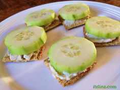 cucumber snack bites with a laughing cow cheese wedge on triscuit crackers | itz linz