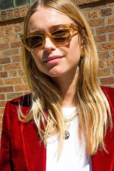 We have yet to find a look from Pernille Teisbaek that we don't love. We're especially diggin' how she put together two of this season's hottest must-haves: translucent sunglasses and a velvet blazer. Both of the items masterfully come together to create quite the stylish statement.