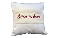 """The pocket holds several letters to Santa from your whole family.  Nubby white linen and velvet trim.  14"""" x 14"""" square.  Merry Christmas!"""