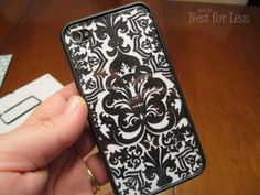 Clear iPhone cover with funky scrapbook paper behind it... duh!  Probably going to steal this idea!