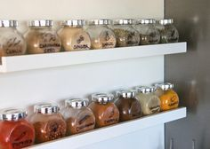 IKEA spice jars on picture ledges with hand drawn labels
