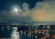 Moment a CHERUB appeared in Sydney night sky to point at the supermoon