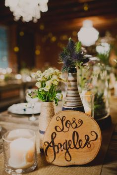 centerpieces with city names as table numbers, photo by Sloan Photographers http://ruffledblog.com/glam-carondelet-house-wedding #weddingideas #tablenumbers