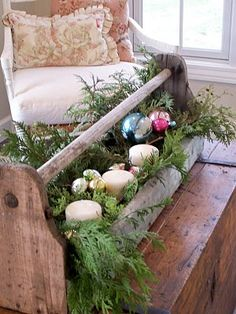old toolbox with fresh pine branches and candles and ornaments