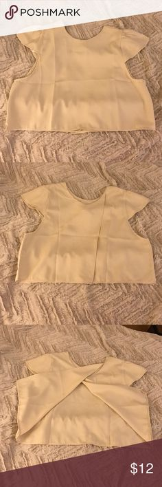 Tan crop top/blouse! This semi & flows crop top has an over lay in the back and ruffled cap sleeves! It has a higher next that can be ticket into a skirt to be more conservative! Never been worn, brand new (but I did take tags off!) says size 6 but is an Australian brand which is a US size 0-2! Sabo Skirt Tops Crop Tops