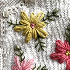 My Embroidered Sweater Project - Betz White Awhile ago I had seen a beautiful sweater that was inspired by a vintage cardigan. I decided to create my own version with wool embroidery. Diy Embroidery Flowers, Simple Embroidery Designs, Wool Embroidery, Embroidery Patterns Free, Machine Embroidery Designs, Knitting Patterns, Embroidered Flowers, Free Knitting, Knitting Projects