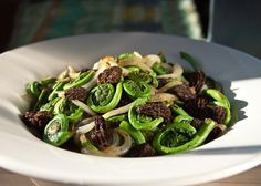 Fiddlehead And Morel Stir Fry: Fiddleheads and morel mushrooms – a pairing that captures the essence of spring.  You can substitute fresh morels for the dried morels used in this recipe, but frankly, I prefer the deep, smoky flavor that  dried morels impart.