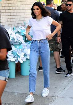 Break time: Kendall completed her look with white sneakers and two diamond rings on one hand