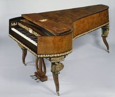This is a Magnificent old Grand Piano http://adjustablepianobench.net