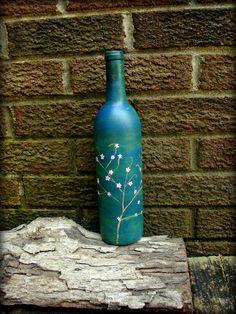 Acrylic painted wine bottles.