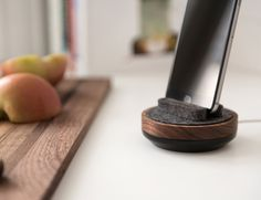 Display and charge your devices like never before. Crafted in the USA from North American hard woods, merino wool felt and a weighty metal base, the Spool Dock keeps your cable tidy and swivels with the touch of a finger.